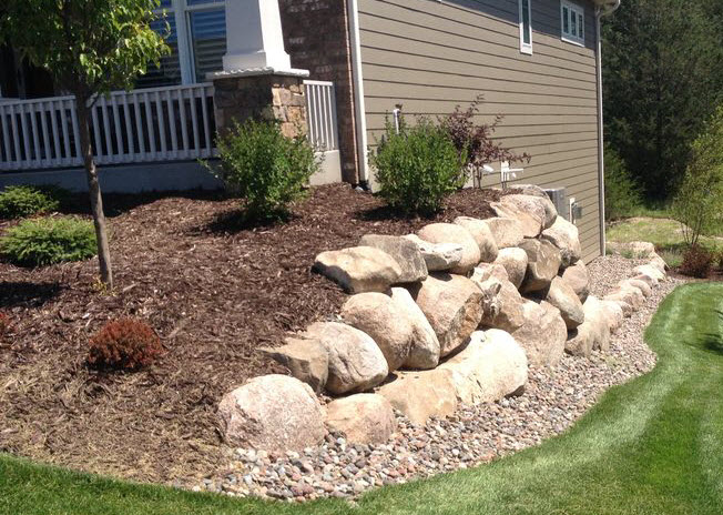 Landscape boulders installation in anoka surrounding for Landscaping rocks
